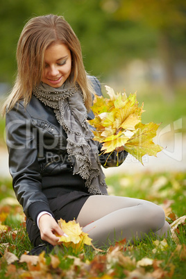 Beautiful girl in the autumn park