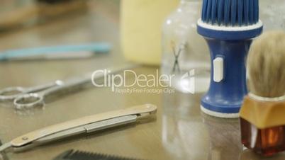 Closeup of tools, scissors, blade and razor in barber shop