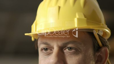 Portrait of happy adult man working as architect with helmet