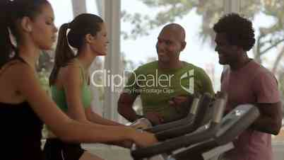 Group of happy friends having fun in fitness club