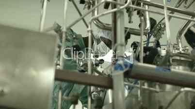 Man checking machinery in pharmaceutical laboratory