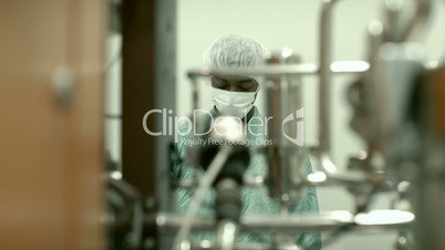 Male researcher checking equipment in biotech industry