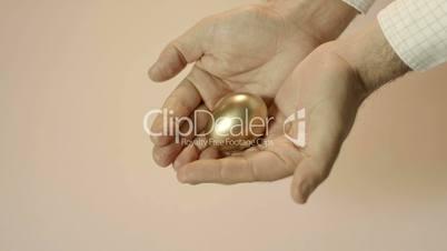 Man showing golden eggs, symbol of money saving