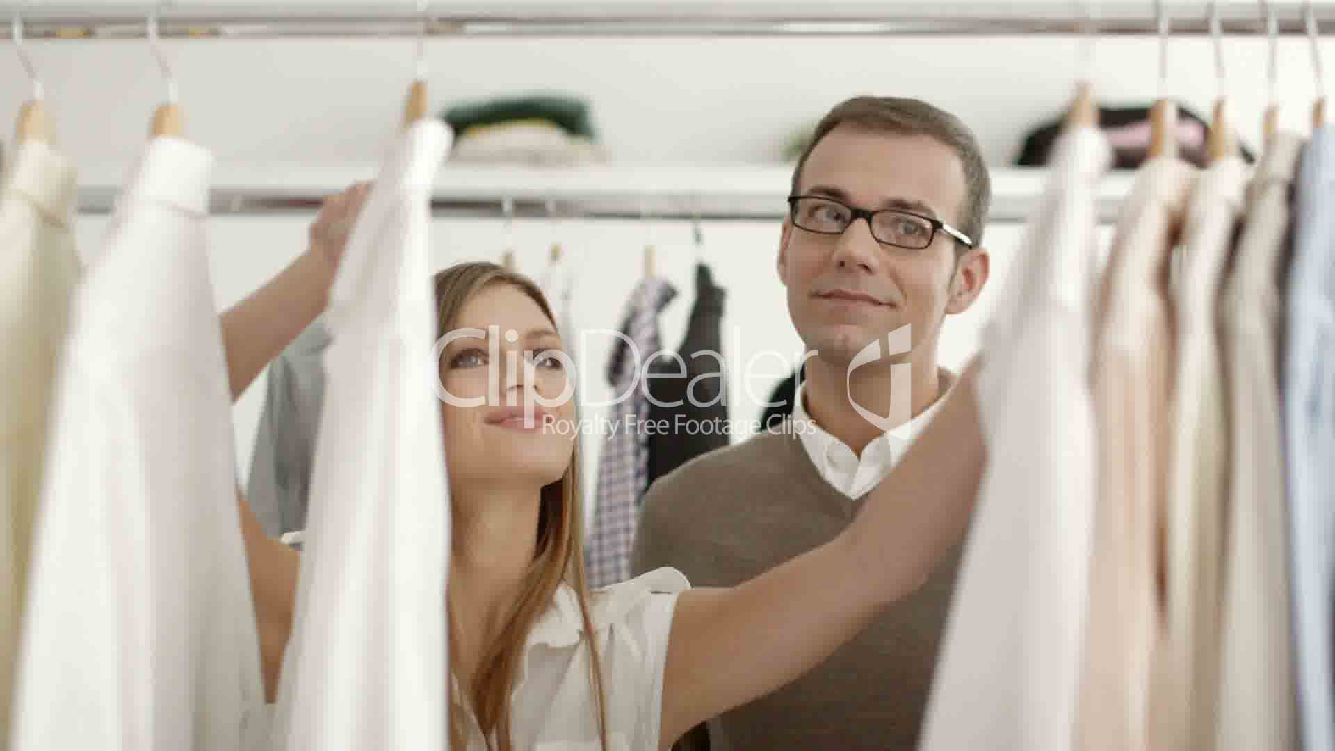 man talking s assistant in clothes shop royalty retail middot s middot s assistant