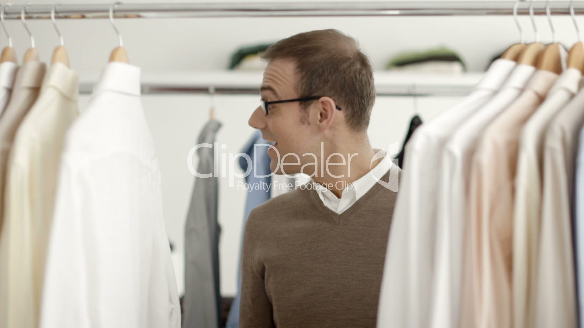 man talking s assistant in clothes shop royalty shop