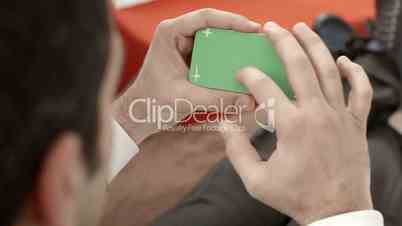 Businessman using smartphone with green screen for web and e-mail