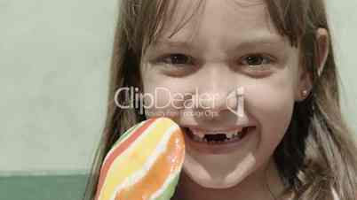Portrait of pretty young girl with candy smiling