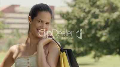 Happy female teen smiling with shopping bags