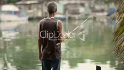 Active senior man fishing on river for hobby