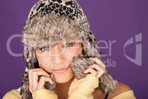 Pretty woman in fur trimmed winter hat