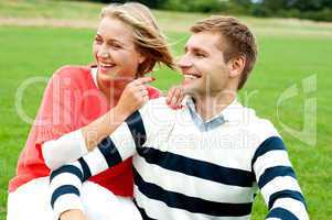 Woman pointing at her lovable husband