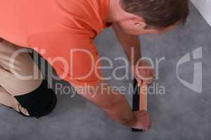 craftsman changing the carpet