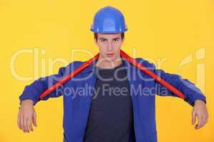 craftsman holding a huge spanner behind his neck