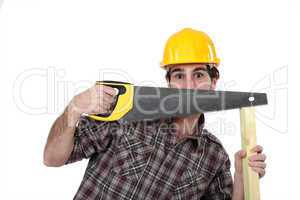 Tradesman hiding behind a saw