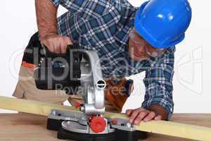 Tradesman using a mitre saw