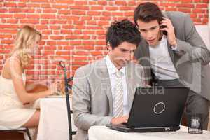 Businessmen connecting with laptop computer