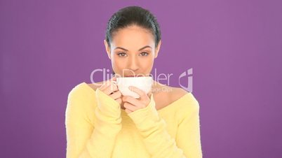 Pretty smiling woman drinking tea