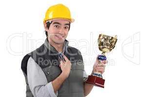 craftsman holding a trophy