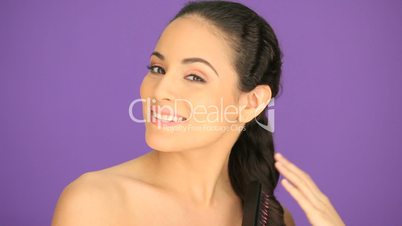 Beautiful brunette brushing her hair
