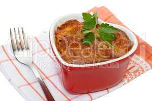 Meat baked in a pot on a white background