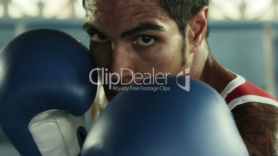 Young caucasian athlete boxing in fitness club