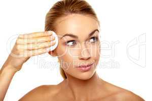 Beautiful woman cleansing her temple
