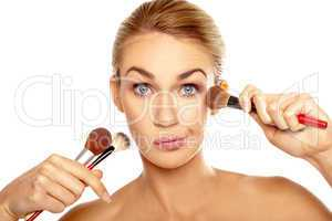 Humorous image of woman with makeup brushes