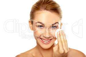 Beautiful woman cleansing her face