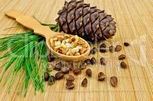 Nuts and cone of cedar on a bamboo mat