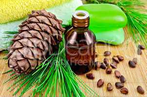 Oil cedar with pine cones and soap