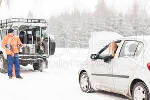 Winter car assistance man help woman breakdown