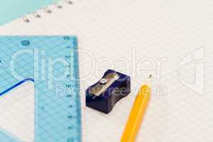 Sharpener with ruler pencil on notepad