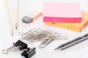 Paper pins with office supplies