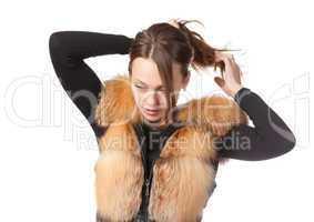 Stylish woman in winter fur jacket
