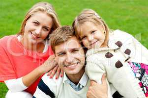 Joyous family of three. Loving and caring