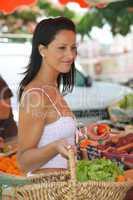 Woman buying fruit and vegetables at outdoors market