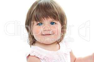 Closeup shot of a chubby female kid with blue eyes