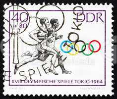 Postage stamp GDR 1964 Two Runners, Tokyo 64