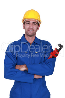 Builder holding red wrench