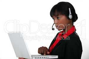 An African American businesswoman at work.