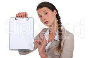 Businesswoman with clip-board