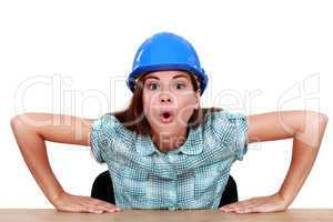 Expressive woman sitting at her desk