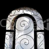 sunlight on dusty arched window