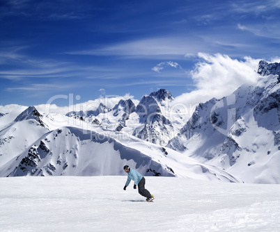 Young snowboarder on ski slope