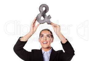Businesswoman holding up an ampersand