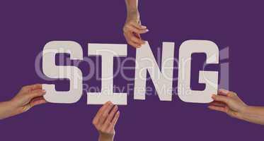 White alphabet lettering spelling SING