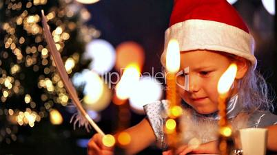 Girl writing with quill pen. Xmas concept