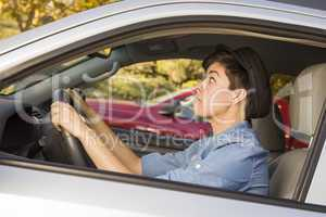 Stressed Mixed Race Woman Driving in Car and Traffic