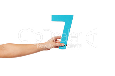 hand holding up the number seven from the left
