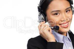 Smiling Asian woman wearing a headset